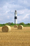 Lighthouse in Kampen with straw bales Royalty Free Stock Photo