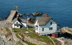 Lighthouse Keeper's Island Home. Lighthouse keeper's home, cottage, and boat slip at the United States Coast Guard Lighthouse Station on a rocky island off the stock image