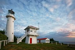 Lighthouse and keepers cottage on Tiritiri Matangi Island open nature reserve, New Zealand royalty free stock photo