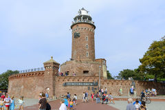 Lighthouse in Kolobrzeg. The area harbor and the lighthouse full of tourists who are watching the city's attractions on 12 August 2015 in Kolobrzeg, Poland Stock Photography