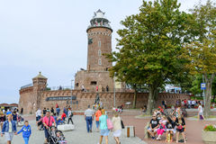 Lighthouse in Kolobrzeg. The area harbor and the lighthouse full of tourists who are watching the city's attractions on 12 August 2015 in Kolobrzeg, Poland Stock Images