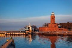 LIGHTHOUSE. KOLOBRZEG, WEST POMERANIAN / POLAND - Lighthouse at sunset royalty free stock photos
