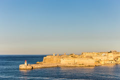 The lighthouse at La Valletta, Malta. One of the two lighthouses situated at the entrance to the port of La Valletta, Malta Stock Images