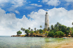Lighthouse, lagoon and  palms Matara Sri Lanka. Lighthouse, lagoon and tropical palms Matara Sri Lanka Stock Photo