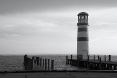 Lighthouse at a lake Royalty Free Stock Photos