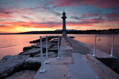 Lighthouse at Lake Geneva. Lake Geneva lighthouse with colourful sunrise in background Stock Photo
