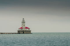 Lighthouse on Lake Michigan. The lighthouse on Lake Michigan provides a reminder that the calm waters can be dangerous for ships royalty free stock image