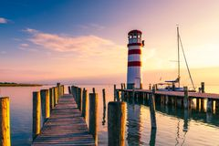 Lighthouse at Lake Neusiedl, Podersdorf am See, Burgenland, Austria. Lighthouse at sunset in Austria. Wooden pier with lighthouse. In Podersdorf on lake royalty free stock images