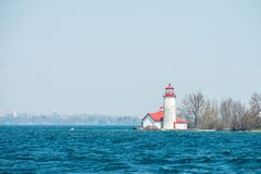 Lighthouse on the lake Ontario. stock images