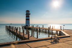 Lighthouse on lake pier bicycle Royalty Free Stock Images
