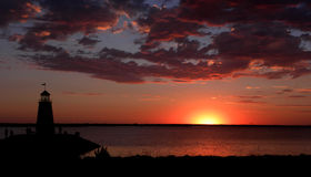Lighthouse and Lake Sunset. Lighthouse overlooking a sunset on Lake Hefner in Oklahoma City stock image