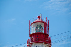 Lighthouse lamp over blue sky background Royalty Free Stock Image