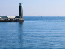 Lighthouse lamp post breakwater, port detail Royalty Free Stock Photography