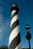 Lighthouse and Lamppost. View of the Historic Lighthouse in St. Augustine, Florida  with Lamppost decorated for the Holiday season in forground Stock Image