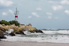 Lighthouse landscape in a stormy weather royalty free stock image