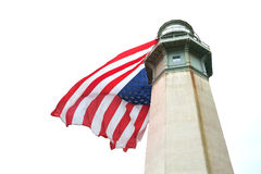 Lighthouse with large American flag. Westport, WA, USA June 11, 2017: Upper portion of the Westport Lighthouse with a large American flag hung vertically from Royalty Free Stock Photos