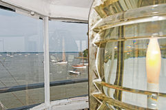 Lighthouse Lens. And view of nearby harbor Stock Photos