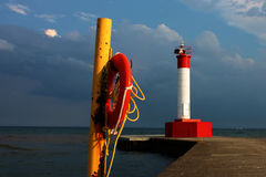 Lighthouse & Life Preserver Stock Photo