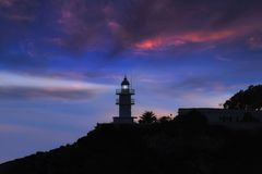 Lighthouse with light beam Stock Images