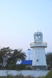 Lighthouse in light blue sky background Royalty Free Stock Image