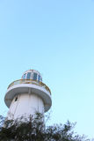Lighthouse in light blue sky background Royalty Free Stock Photos