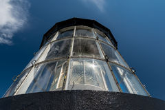 Lighthouse light detail isolated on a blue  sky Stock Photography