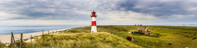 Lighthouse List Ost on the island Sylt. The lighthouse List Ost on the Ellenbogen of the island Sylt at the german northern sea coast Royalty Free Stock Photo