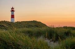Lighthouse List-Ost on the island Sylt, Germany. Lighthouse List-Ost on the island Sylt at sunset stock image