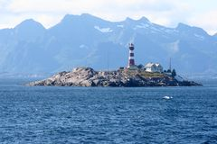 Lighthouse on the little rocky isle stock photos