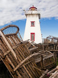 Lighthouse and Lobster Traps, PEI, Canada Royalty Free Stock Photo