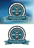 Lighthouse logo or emblem in retro blue Royalty Free Stock Image