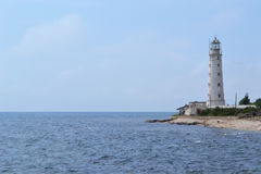 Lighthouse. A lonely white lighthouse specifies a way ashore sea Stock Photos