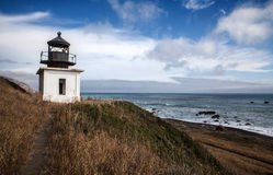 Lighthouse on the Lost Coast in California. Hiking trail on the beach Stock Image