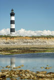 Lighthouse at low tide Royalty Free Stock Image