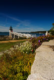 Lighthouse Maine. Maine coast lighthouse Marshall Point  Lighthouse reflection summer blue sky tourism tourist attraction north atlantic beacons landscapes Stock Photos