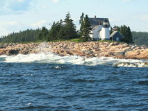 Lighthouse in Maine USA. Picture taken in the Atlantic Ocean, close to Bar Harbor Maine, USA Royalty Free Stock Image