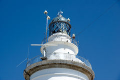 Lighthouse of Malaga harbor. Detail of the top Royalty Free Stock Photography