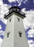 Lighthouse with blue skies and white clouds Royalty Free Stock Photography