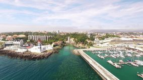 Lighthouse and marina of Cascais Portugal aerial view stock video