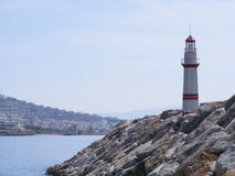 Lighthouse Marina Entrance. A read and white lighthouse warns boats of the entrance to Turgutreis marina near Bodrum in Southwest Turkey Stock Image