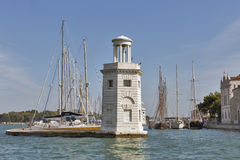 Lighthouse and marina at San Giorgio Maggiore island, Venice, Italy. Stock Photography