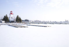 Lighthouse and Marina in the Snow Royalty Free Stock Photos