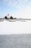 Lighthouse and Marina in the Snow Stock Photography