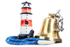 Lighthouse  and marine bell Stock Photography