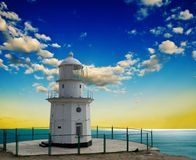 Lighthouse on a marine cape Royalty Free Stock Images