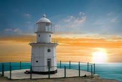 Lighthouse on marine cape Royalty Free Stock Photo