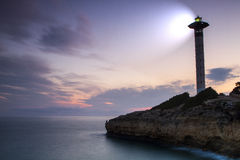 Lighthouse for maritime navigation. In the night Royalty Free Stock Images