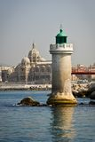 Lighthouse and Marseille cathedral. On the background, France Royalty Free Stock Image