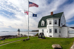 Lighthouse Marshall Point with flags in Maine stock images