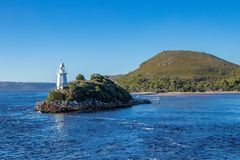 Lighthouse at Mcquarie Harbour entrance stock photography